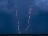 Lightning Strikes on the Duba Plains Photographic Print by Beverly Joubert
