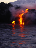 Glowing Lava Flowing into the Sea Photographic Print by Patrick McFeeley