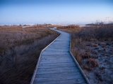 A Wooden Walkway across Marshland Toward the Ocean Photographic Print by Karen Kasmauski