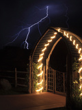 A Lightning Bolt Comes Out of Night Sky Near a Farm Gate Photographic Print by Robbie George