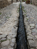 An Ancient Inca Stone Street with a Water Sluice Running Through It Photographic Print by Kent Kobersteen