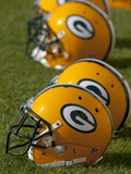 Packers Training Camp: Green Bay, WISCONSIN - Green Bay Packers Helmets Photographic Print by Mike Roemer