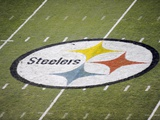 Titans Steelers Football: Pittsburgh, PA - Steelers logo on Heinz Field Plakater av Don Wright