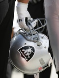 Raiders Chiefs Football: Kansas City, MO - Oakland Raiders Helmet Photographic Print by Ed Zurga