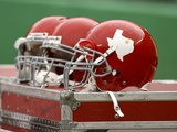 Cowboys Chiefs Football: Kansas City, MO - Chiefs Throwback Helmets Photographic Print by Ed Zurga