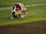 Patriots Redskins Football: Landover, MD - A Washington Redskins Helmet Photographic Print by Pablo Martinez Monsivais