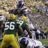 Vikings Packers Football: Green Bay, WI - Adrian Peterson Photographic Print by Mike Roemer
