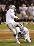 Chargers Raiders Football: Oakland, CA - Sebastian Janikowski and Shane Lechler Photographic Print by Marcio Sanchez