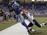Browns Lions Football: Detroit, MI - Calvin Johnson Photographic Print by Paul Sancya