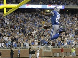 Packers Lions Football: Detroit, MICHIGAN - Calvin Johnson Prints by Paul Sancya