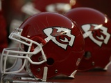 Seahawks Chiefs Football: Kansas City, MO - Chiefs Helmets Photographic Print by Ed Zurga