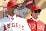 Los Angeles Angels of Anaheim, CA - December 10: Newly Signed Albert Pujols and C.J. Wilson Photographic Print by Stephen Dunn