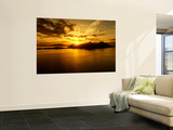 A Gas Giant and Multiple Moons Look Down on a Beautiful Island Sunset Wall Mural by  Stocktrek Images