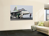 An F/A-18 Super Hornet Is Ready to Launch from a Catapult Aboard Uss Harry S. Truman Wall Mural by  Stocktrek Images