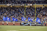 Redskins Lions Football: Detroit, MI - Lions Flags Photographic Print by Carlos Osorio