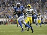 Packers Lions Football: Detroit, MICHIGAN - Calvin Johnson Fotografisk trykk av Paul Sancya