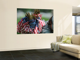 An Army Soldier's Backpack Overflows with Small American Flags Wall Mural by Stocktrek Images