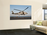 A Us Navy Sh-60F Seahawk Hovers Above the Flight Deck of Uss Eisenhower Wall Mural by Stocktrek Images