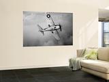 A Grumman F6F Hellcat Fighter Plane in Flight Wall Mural by  Stocktrek Images