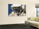 A Russian Cosmonaut Wearing a Russian Orlan Spacesuit During a Spacewalk Wall Mural by  Stocktrek Images
