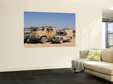 A British Armed Forces Snatch Land Rover Parked Next to Other Military Vehicles Wall Mural by  Stocktrek Images