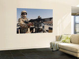 A British Army Soldier Mans a Machine Gun Mounted on Top of a Land Rover Wall Mural by  Stocktrek Images