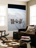 The International Space Station in Orbit Above Earth Wall Mural by  Stocktrek Images