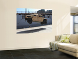A Crane Lifts an M998 Humvee on the Flight Deck of USS Carter Hall Wall Mural by  Stocktrek Images