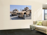 An M-Atv Mine Resistant Ambush Protected Vehicle Parked Next to a Maxxpro Mrap Wall Mural by  Stocktrek Images