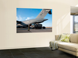 A Japanese Soldier Marshals Vehicles from a C-17 Globemaster Iii Wall Mural by  Stocktrek Images