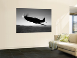 A Grumman F6F Hellcat Fighter Plane in Flight Wall Mural by  Stocktrek Images