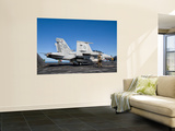 An F/A-18F Super Hornet Moves into Launch Position Aboard Aircraft Carrier Uss Nimitz Wall Mural by  Stocktrek Images