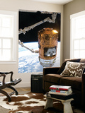 The Japanese H-Ii Transfer Vehicle in the Grasp of Canadarm2 Wall Mural by  Stocktrek Images
