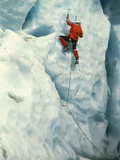 Mountain climber at ice wall Photographic Print by Beat Glanzmann