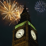 Low angle view of Big Ben, London, England, with fireworks bursting overhead Photographic Print
