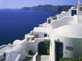 Apartment block in Oia, Santorin, Greece Photographic Print by Guenter Rossenbach