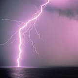 Lightning across the sea Photographic Print by Klaus Hackenberg