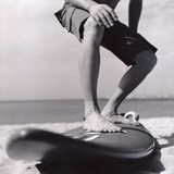 Young Man Standing on Surfboard on the Beach Photographic Print by Daniel Attia