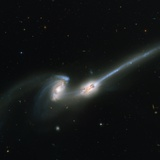 Two Merging Galaxies Photographic Print
