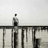 Young Man on Piling Photographic Print by JoSon 