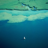 Sailing boat on lake, Bavaria, Germany Photographic Print by Klaus Leidorf