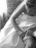 Bride Pulling Up Garter Photographie par Abraham Nowitz