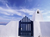 Blue Gate and White Wall, Oia, Santorin, Cyclades, Greece Photographic Print by Sergio Pitamitz