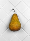 Pear in front of white background Photographic Print by Christopher Stevenson