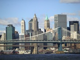 Skyline of New York City with East River, Manhattan and Brooklyn Bridge Photographie par Alan Schein