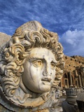 Sculpture of Medusa's Head at Leptis Magna Photographic Print by Wolfgang Kaehler