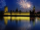 Fireworks exploding over the Houses of Parliament and the river Thames, London, England Photographic Print