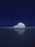 Illuminated Igloo at Frozen Lake Photographic Print by Beat Glanzmann