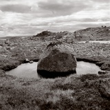 Rock in water at coast (black nad white) Photographic Print by  Mika