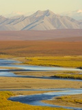Mountains and Winding River in Tundra Valley Photographic Print by John Eastcott & Yva Momatiuk